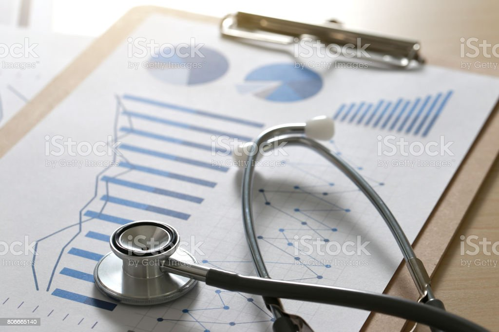 financial report chart and calculator Medical Report and stethoscope financial report chart and calculator Medical Report and stethoscope Audit Stock Photo