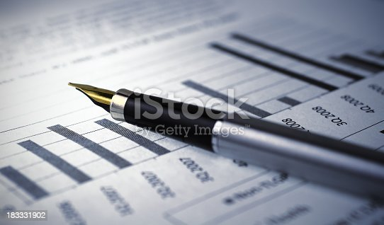 953919718istockphoto Financial report graph with pen 183331902