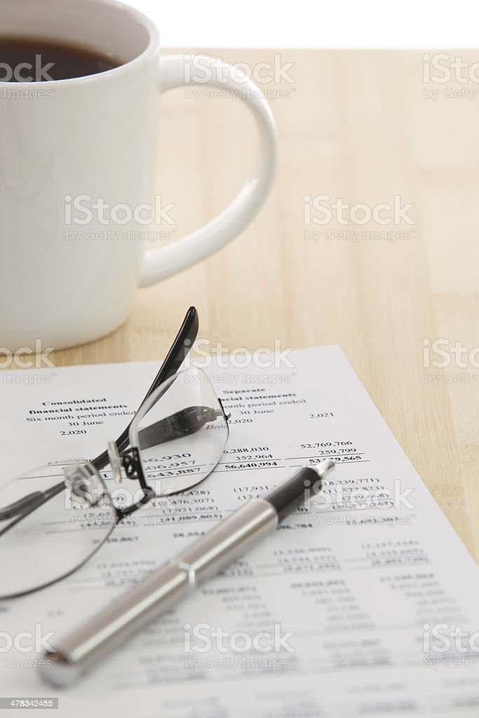 Financial report with calculator on table royalty-free stock photo
