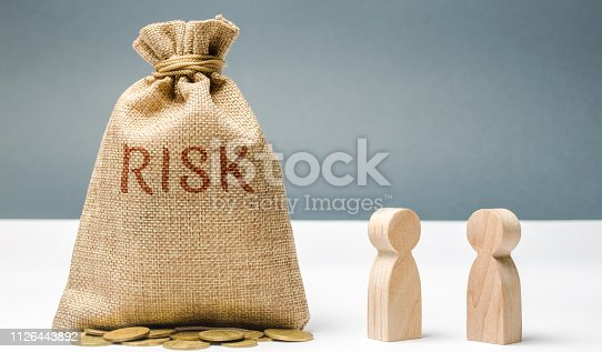 1018458132istockphoto Financial risk management concept. Businessmen discuss methods to avoid financial crisis. The process of making and implementing management decisions. Fraud in the company. Unreliable team 1126443892