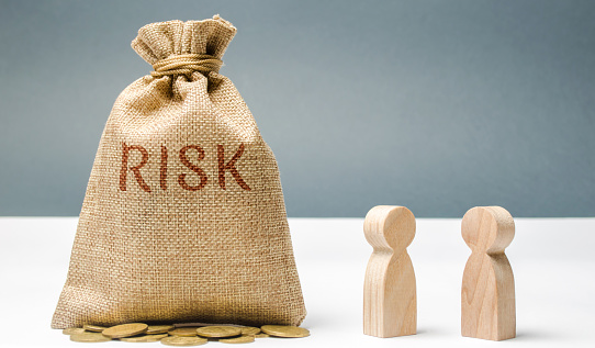 1018458132 istock photo Financial risk management concept. Businessmen discuss methods to avoid financial crisis. The process of making and implementing management decisions. Fraud in the company. Unreliable team 1126443892
