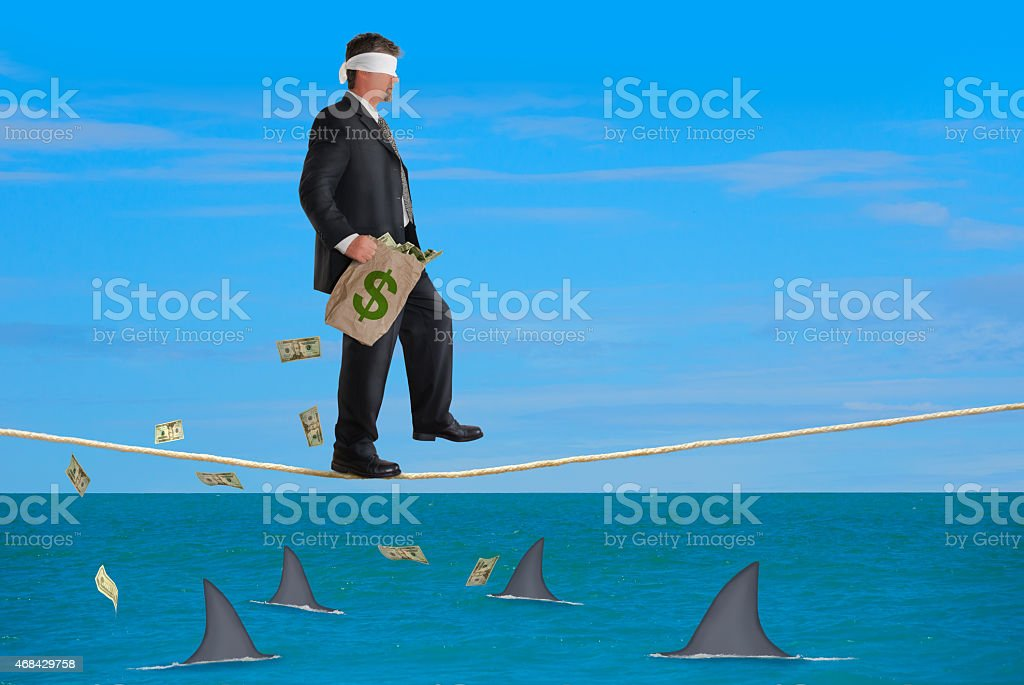 Financial Risk Success Plan Blindfolded Man Walking Tightrope stock photo