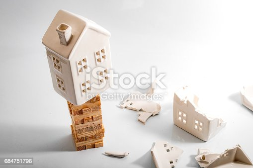 istock Financial risk, unstable real estate investment and shaky housing market 684751796