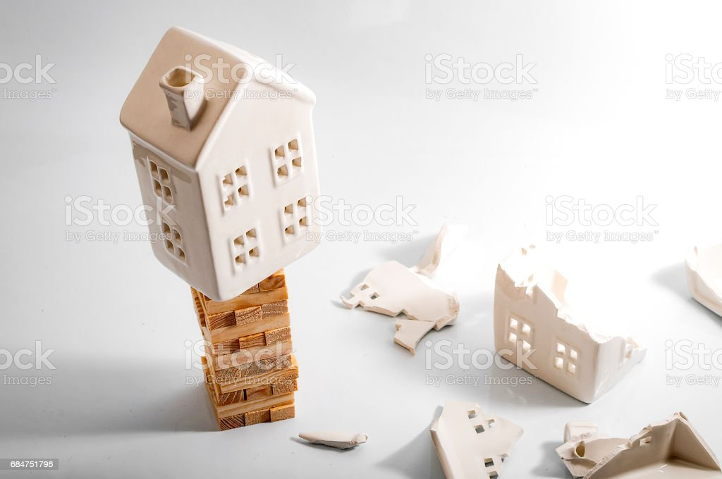 Financial risk, unstable real estate investment and shaky housing market stock photo