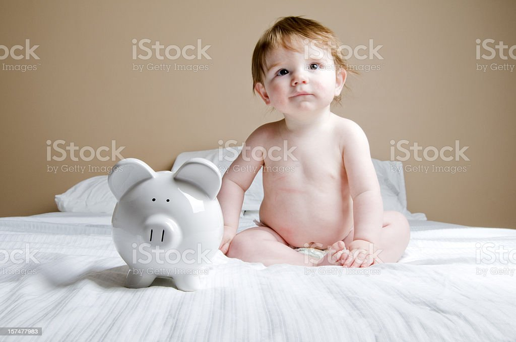 Financial Security Concept, Baby and Piggy Bank stock photo