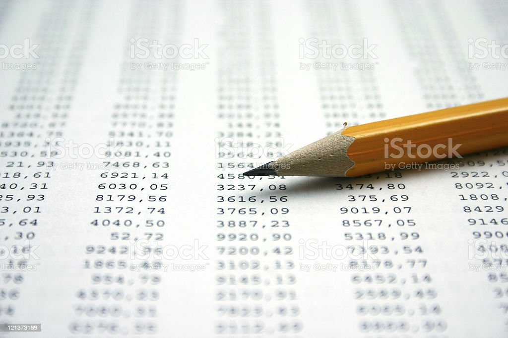 Financial Sheet and Pencil stock photo