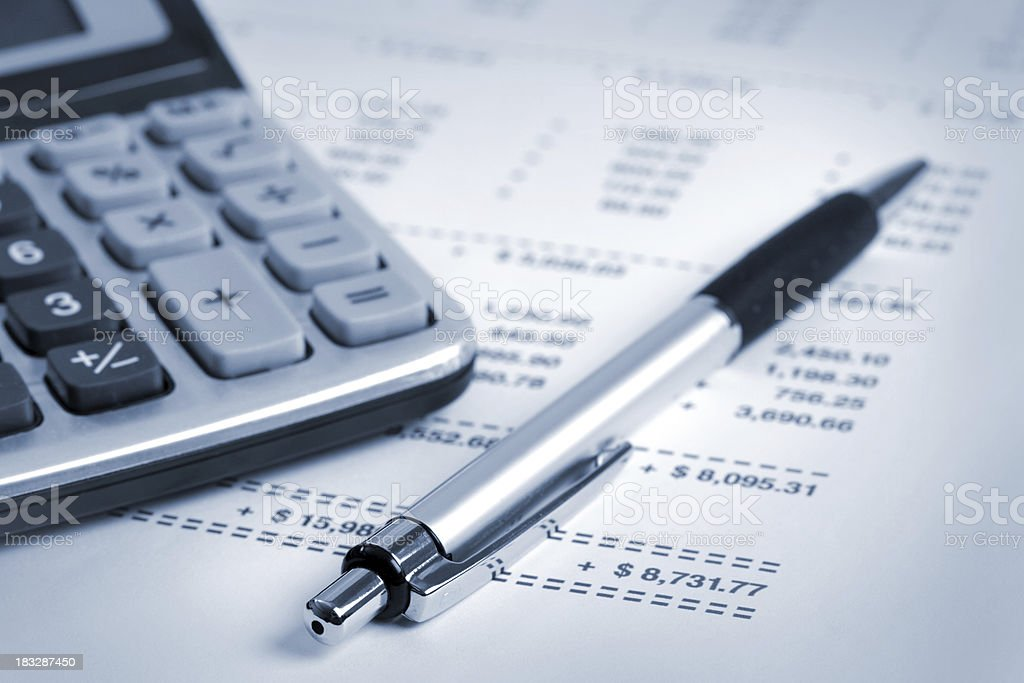 Financial statement with pen and calculator royalty-free stock photo