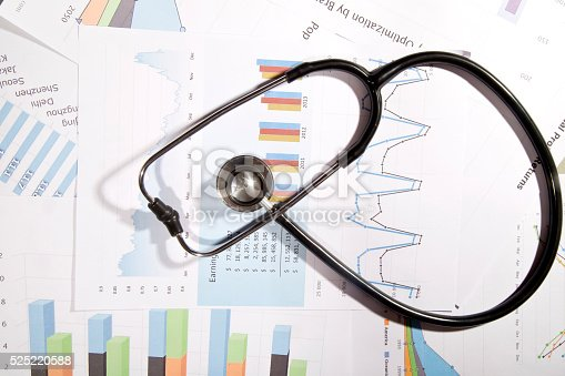 184621300 istock photo Financial statement with stethoscope 525220588