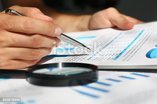 istock Financial statistics documents on clipboard pad at office table closeup 845918536