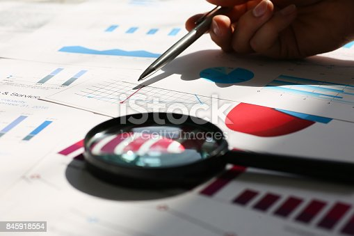 istock Financial statistics documents on clipboard pad at office table closeup 845918554