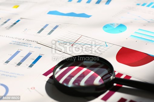 istock Financial statistics documents on table 845918520