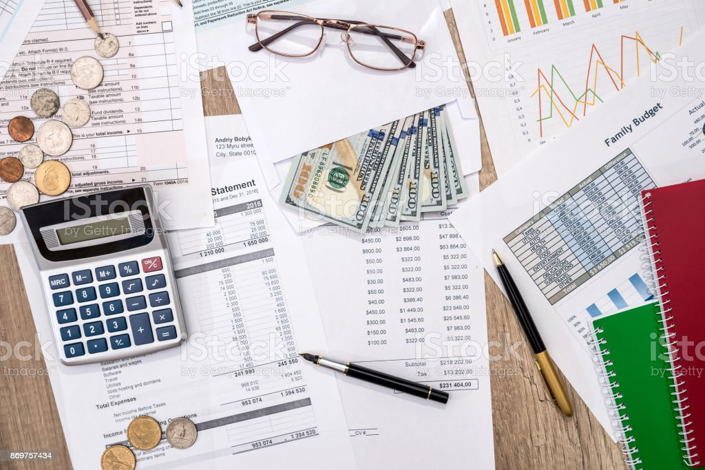 financial statistics documents tax form personal budget with money
