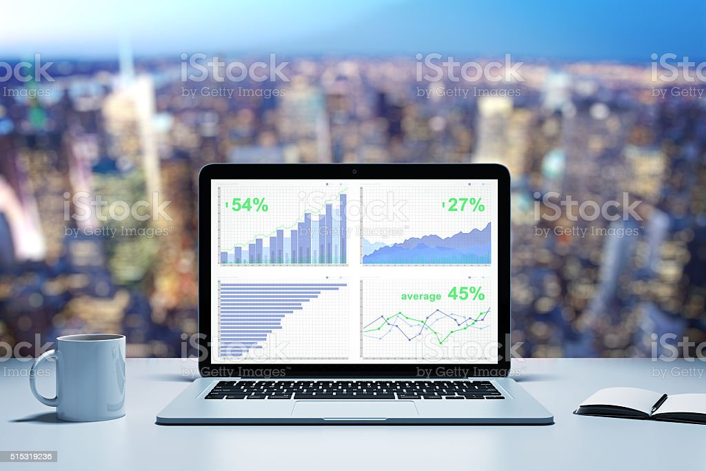 Financial statistics with business charts on laptop screen stock photo