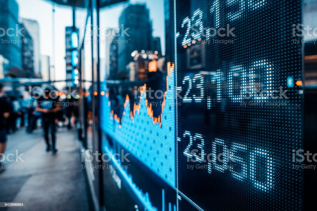Financial stock market numbers and city light reflection stock photo