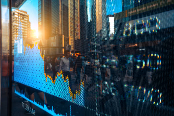 Financial stock market numbers and city light reflections stock photo