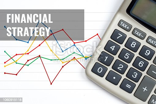 istock financial strategy, business concept with calculator and colorful charts 1060915118
