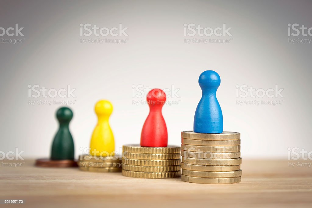 Financial success concept with game figurines stock photo