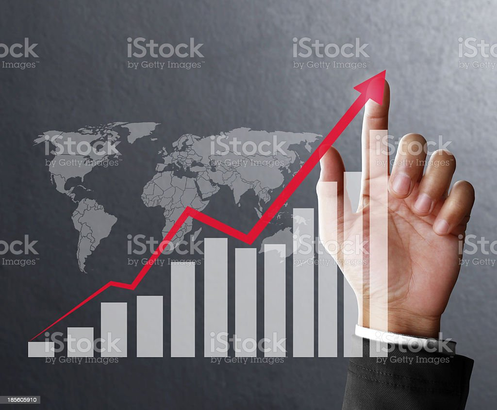 financial symbols coming from hand stock photo