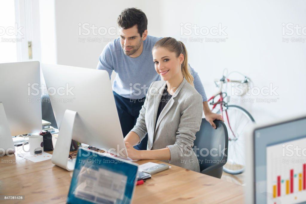 Financial team discussing stock photo