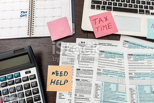 184625018 istock photo Financial time tax form with laptop and calculator. Office paperwork 1218621131