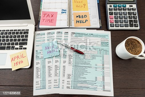 184625018 istock photo Financial time tax form with laptop and calculator. Office paperwork 1221639533