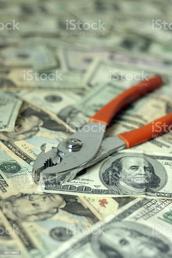 Financial Tools - Pliers on Cash stock photo
