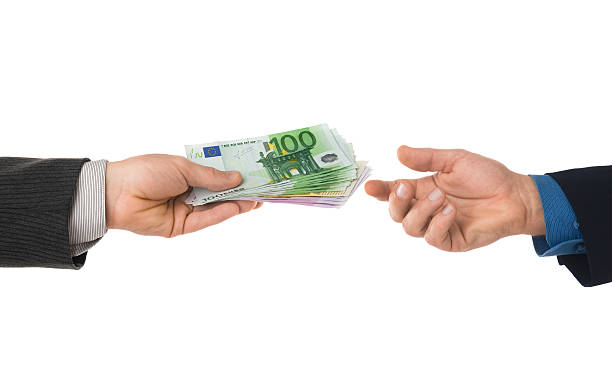 A financial transaction between two parties Businessmen handing stack of euro notes isolated on white euro symbol stock pictures, royalty-free photos & images