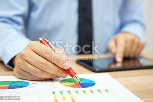 istock financial worker analyzing business data and working with tablet computer 508126658