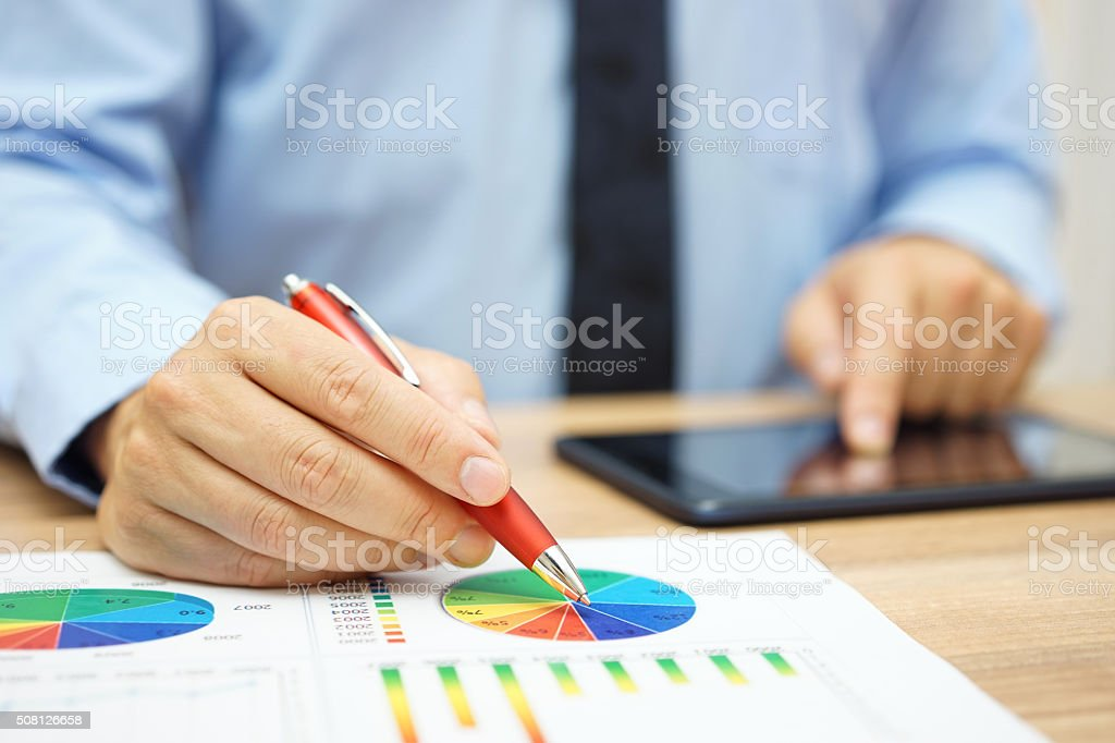 financial worker analyzing business data and working with tablet computer stock photo