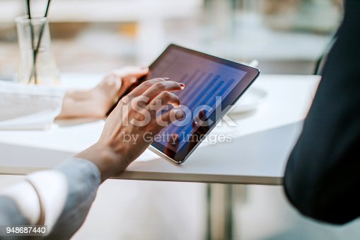 Woman use digital tablet in cafe