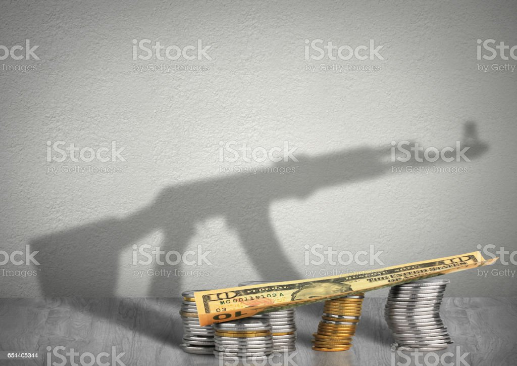 financing terrorism concept, money with weapon shadow stock photo