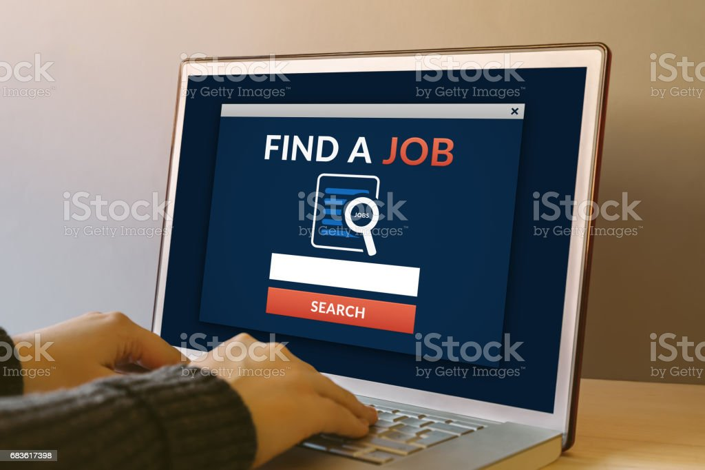 Find a job concept on laptop computer screen on wooden table stock photo