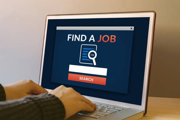 find a job concept on laptop computer screen on wooden table - apply online stock photos and pictures