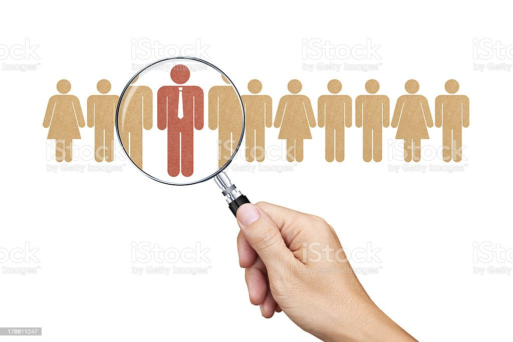 Find an employee with a magnifying glass royalty-free stock photo