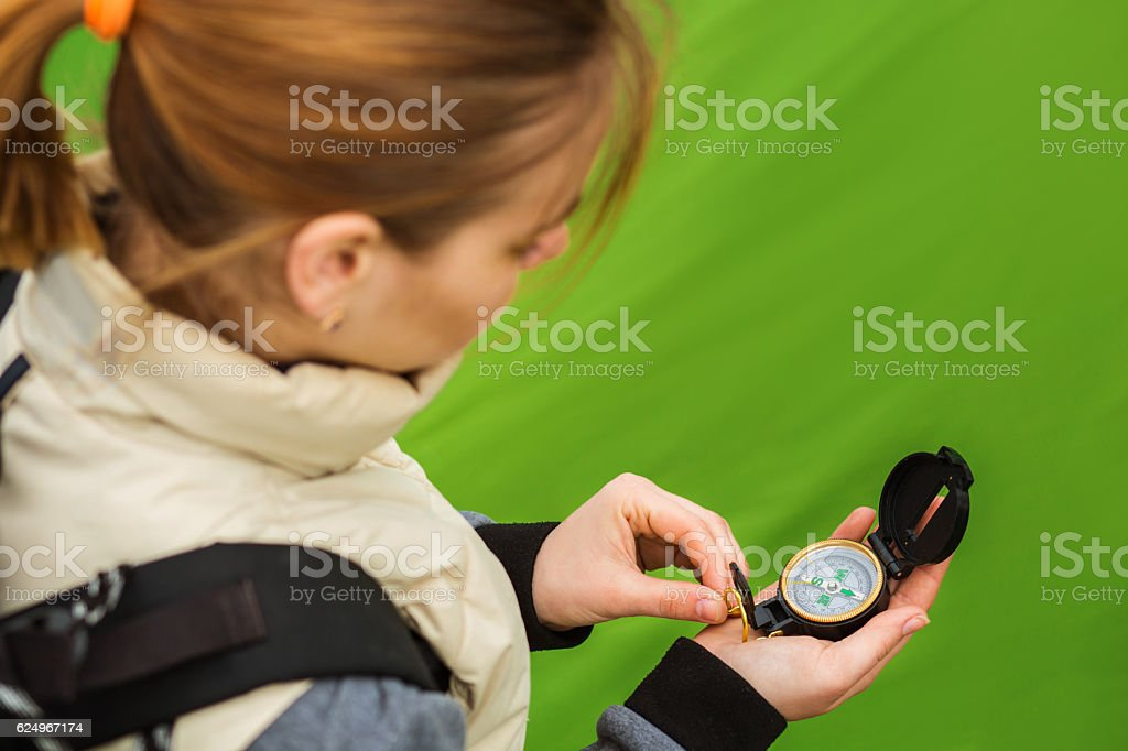Find directions using the compass stock photo