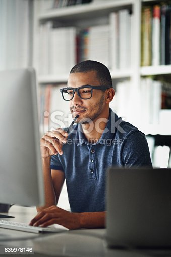 Cropped shot of a businessman using his computer in his home office