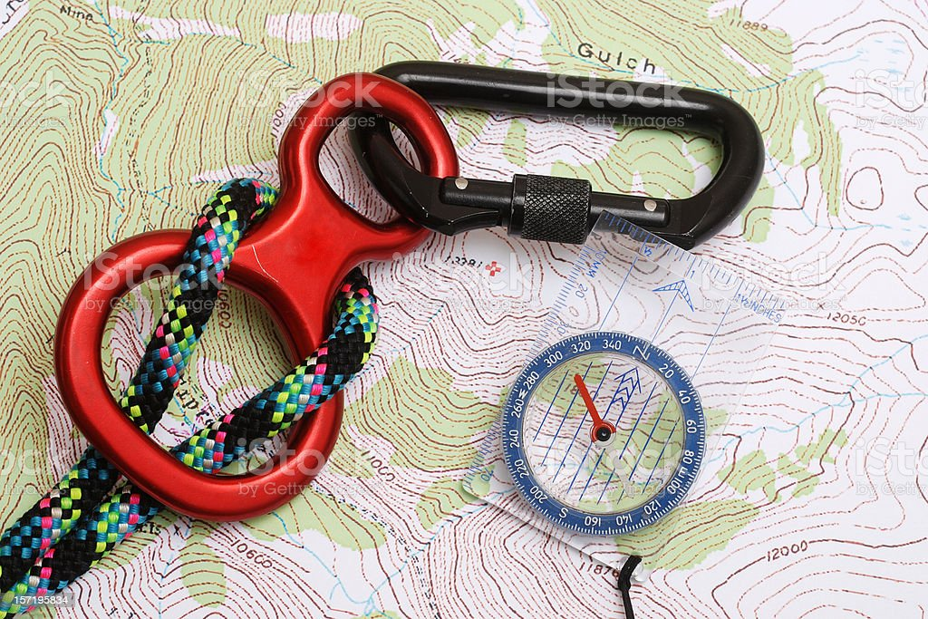 Find the Mountain, Compass, Rope & Carabiner On Topo Map stock photo