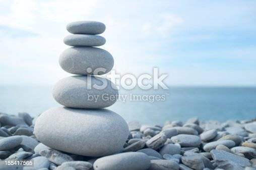 Abstract background decorative mosaic plaster. Stucco backdrop with rocks crumbs. Pebble plaster finishing - surface coating made of small stones