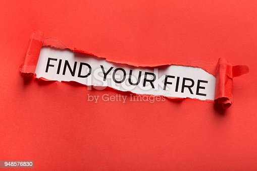 520244535 istock photo Find your fire inscription showing up behind red torn paper 948576830