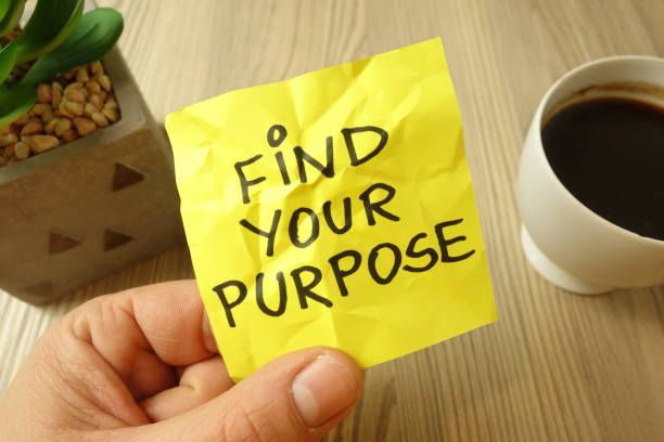 Find your purpose - motivational reminder handwritten on sticky note stock photo
