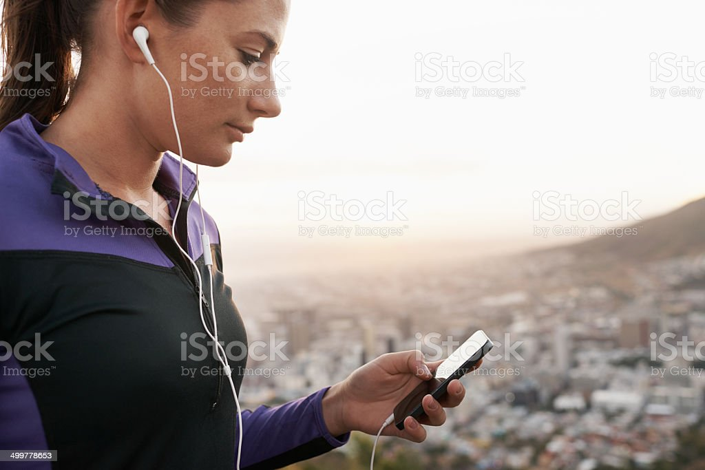 Finding a theme song for her jog stock photo