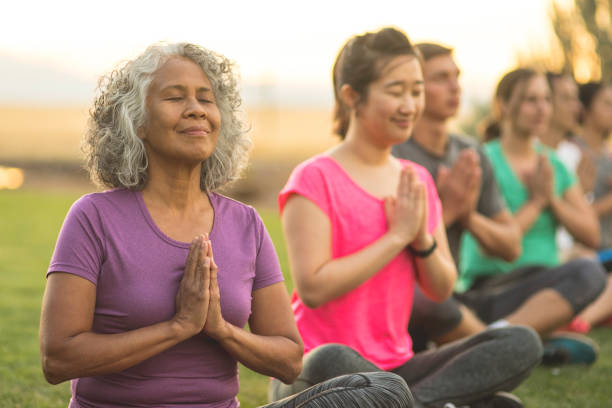 finding balance in retirement - yoga stock photos and pictures
