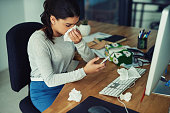 istock Finding her GP's number in her contacts list 889151736