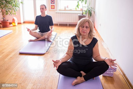 istock Finding inner peace in yoga class 673564314