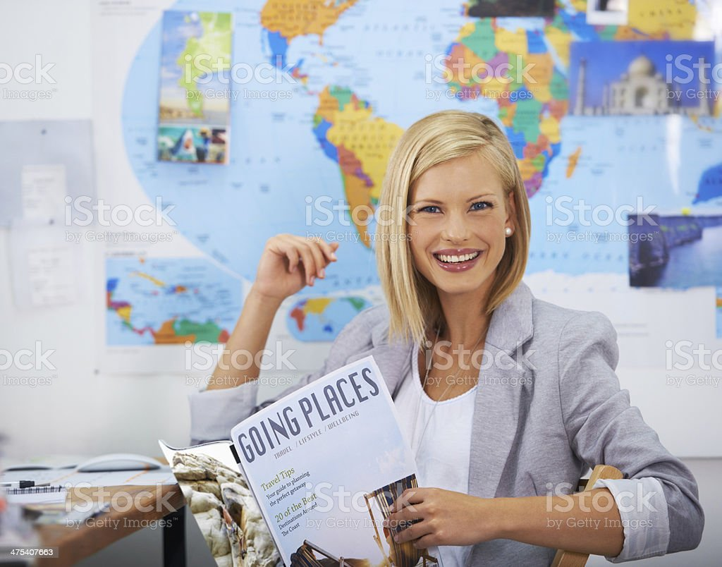 Finding inspiration in a travel magazine stock photo