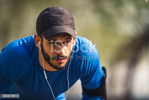 Portrait of a handsome runner listening to the music.