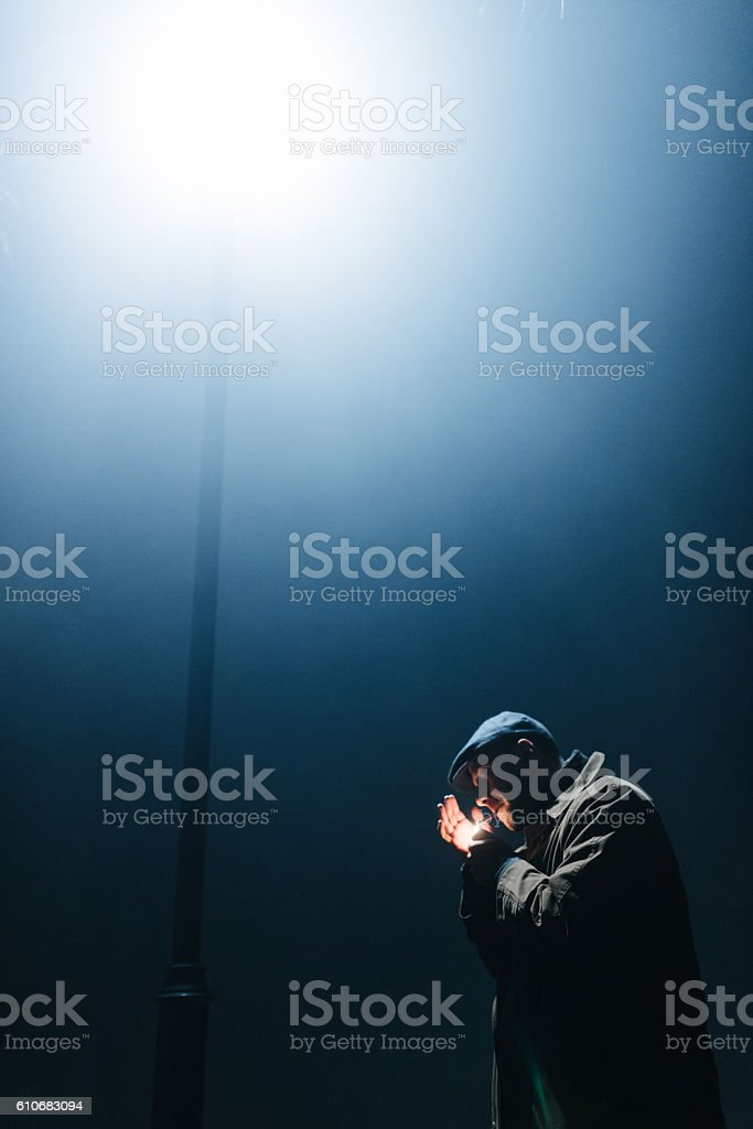 Finding light in the darkness stock photo