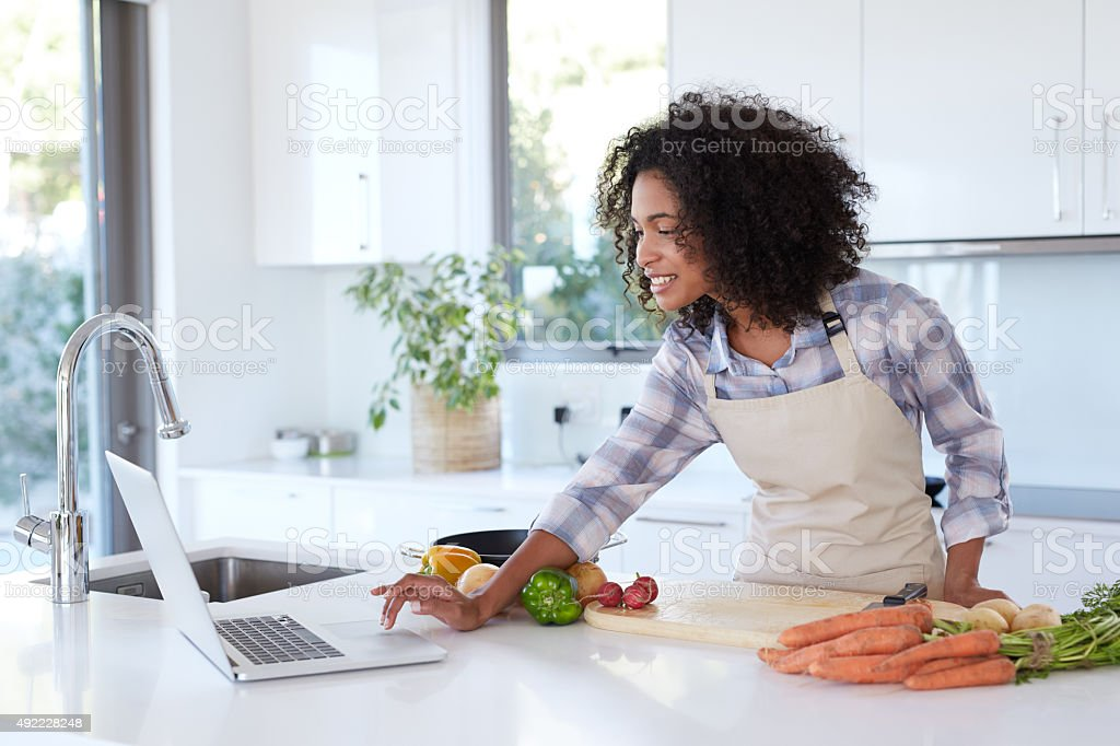 Finding the perfect recipe online stock photo