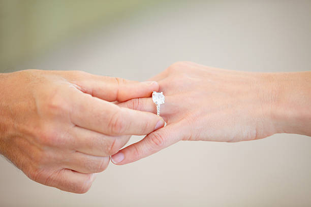 finding the right one - marriage and engagement - diamond ring hand stock photos and pictures