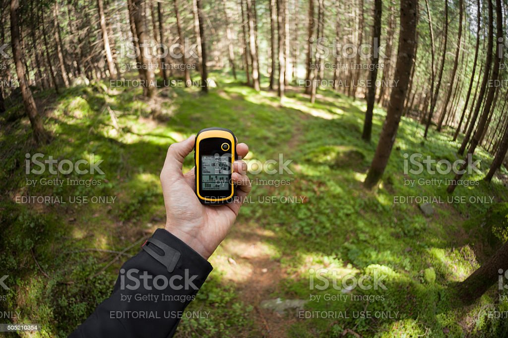 finding the right position in the forest via gps stock photo